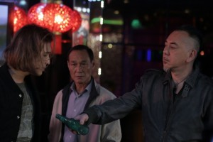 """Ghost (Anthony Wong, right) lends his """"hing dai"""" Leung (Wong You Nam, left) a hand in """"Gangster Pay Day."""" (photo courtesy of the Busan International Film Festival)"""