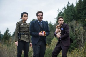 "(L-R) Diana Bang, Seth Rogen, a cute puppy, and James Franco in ""The Interview."" (still courtesy of Columbia Pictures)"