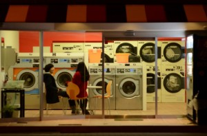 "The two main characters not at a radio station, but at a laundromat in ""Antonym."" (still courtesy of the Nippon Connection Japanese Film Festival)"