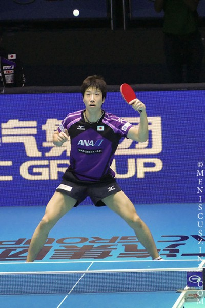 Keeping his eye on the ball: Jun Mizutani of Japan during his victory over Dimitrij Ovtcharov in the 2014 ITTF Grand Tour World Finals. The players' rivalry stretches back 15 years. (photo by Yuan-Kwan Chan / Meniscus Magazine)