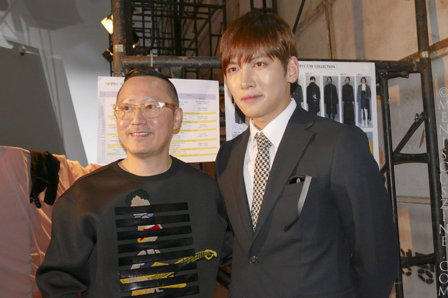 KAAL E.SUKTAE designer Lee Suk Tae (left) with actor Ji Chang-wook backstage after the conclusion of the Fall 2015 women's show. (photo by Yuan-Kwan Chan / Meniscus Magazine)