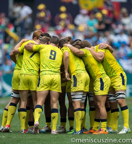Team Australia huddles during its Cup quarterfinal loss to South Africa. (photo by Christiaan Hart / Meniscus Magazine)