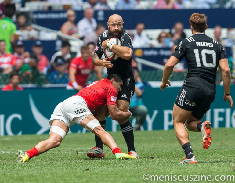 New Zealand captain DJ Forbes (center) in quarterfinal action against Argentina. (photo by Christiaan Hart / Meniscus Magazine)