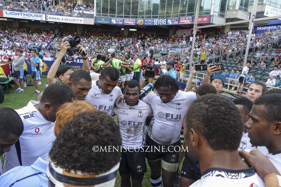 The Fiji squad huddles and meditates after their victory over South Africa in the semifinals. (photo by Yuan-Kwan Chan / Meniscus Magazine)