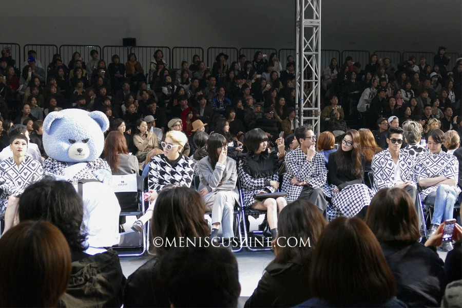 The front row at the pushbutton Fall 2015 runway show at Seoul Fashion Week included the YG Bear; rapper Zico of Block B (third from left); Bae Doona (center); Kim C (fourth from right); Jung Eun-chae (third from right); Bae Jeong-nam (second from right); and actor Kim Ji-hoon (right). (photo by Yuan-Kwan Chan / Meniscus Magazine)