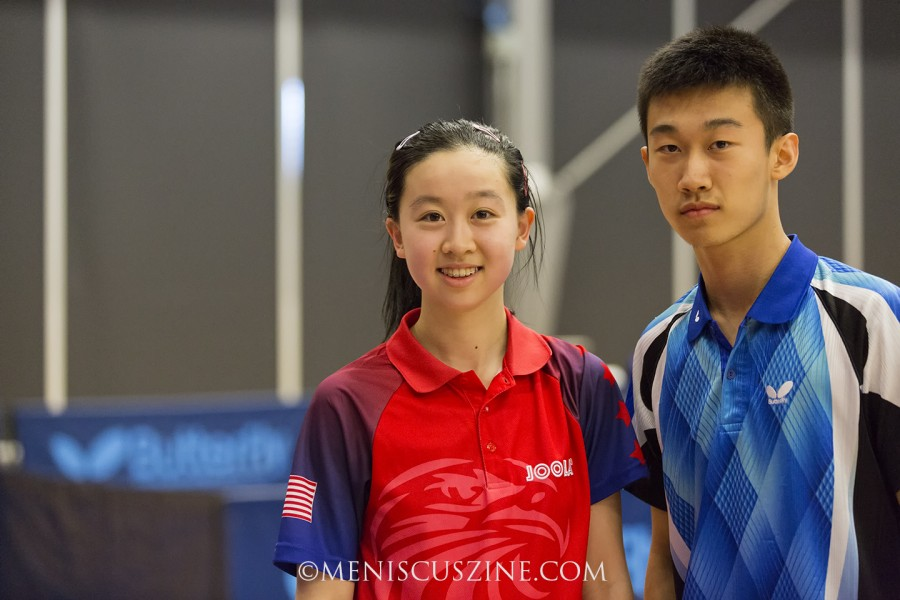 Angela Guan (left), shown with the junior boys' champion, Zhang Kai, also entered the ITTF North American Cup, a senior event that took at the same venue in Markham, Ontario. She reached the quarterfinals, losing 3-11, 7-11, 13-11, 9-11, 11-9, 11-4, 12-10 to Amy Wang. (photo by Kwai Chan / Meniscus Magazine)
