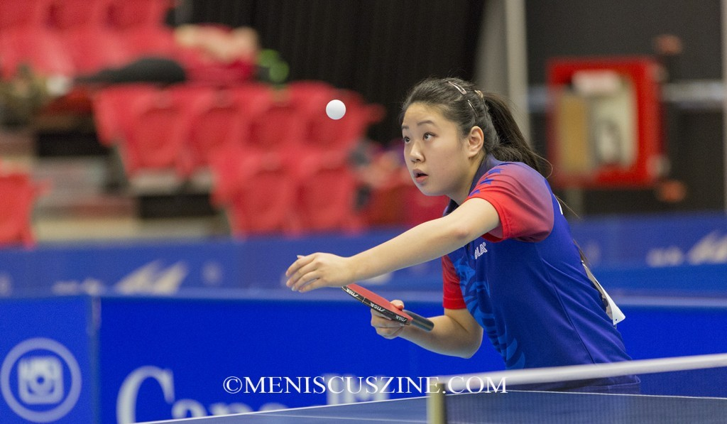 Currently a student at the University of California, Berkeley, Lily Zhang is the first American to medal at an international Olympic-level event (a bronze in singles at the Nanjing 2014 Youth Olympic Games) and part of the first North American team to win a world junior medal (the U.S. girls won the bronze at the 2014 World Championships). (photo by Kwai Chan / Meniscus Magazine)
