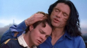 """Johnny (Wiseau, right) comforts Denny (played by Philip Haldiman) in a scene from """"The Room."""" (photo courtesy of the Tribeca Film Festival)"""