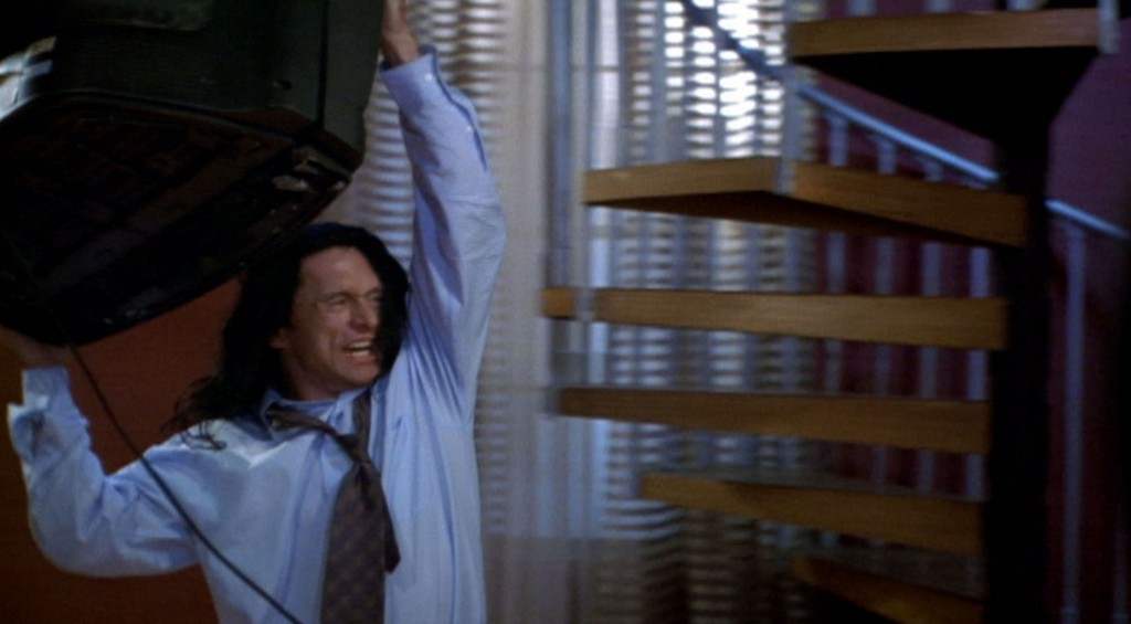 """Tommy Wiseau in a dramatic scene in """"The Room."""" (still courtesy of the Tribeca Film Festival)"""