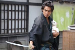 "Kazuki Kitamura and his feline friend in ""Neko Samurai."" (still courtesy of the Japan Society)"