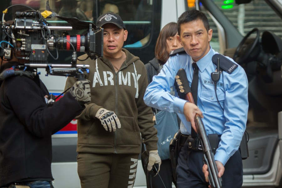 "Director Dante Lam (left) and actor Nick Cheung during the filming of ""That Demon Within."" (still courtesy of China Lion Film Distribution Inc.)"