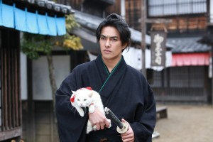 "Kazuki Kitamura once again playing second fiddle to the cat in ""Neko Samurai 2."" (still courtesy of JAPAN CUTS 2015)"