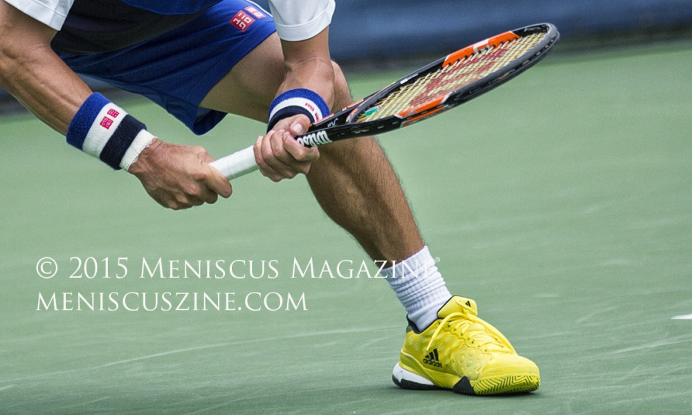 """""""I'm happy with the shoes,"""" Nishikori said of the adidas Barricade 2015 Yellow Men's Shoes, which retail for US$129.95. """"I love the bright color, too. [The adidas shoes are] actually for the U.S. Open, but I [decided] to use them beforehand."""" (photo by Kwai Chan / Meniscus Magazine)"""