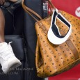 During her press conferences at the 2015 Rogers Cup, we noticed two items worn by Serena Williams: the MCM Reversible Visetos Shopper and OVO x Air Jordans.
