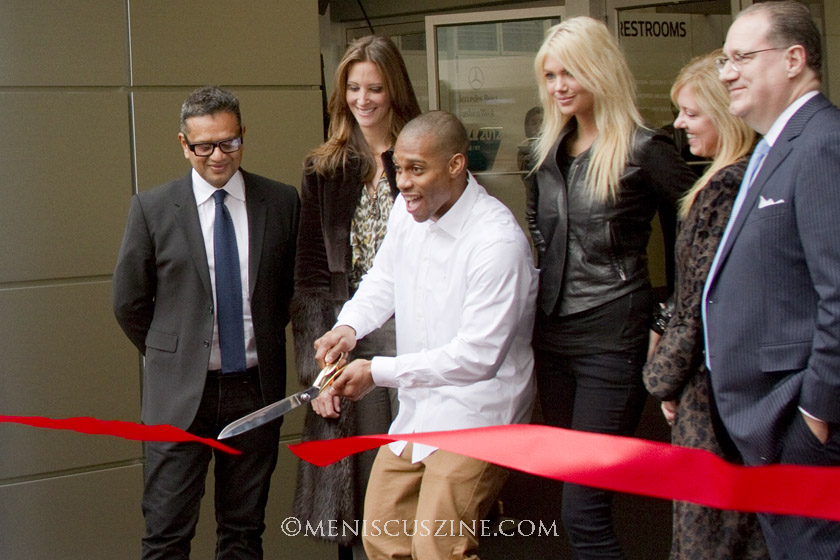 Fashion designer Naeem Khan (far left); Victor Cruz of the Super Bowl champion New York Giants (cutting the ribbon); and model Kate Upton (third from right). (photo by Kwai Chan / Meniscus Magazine)