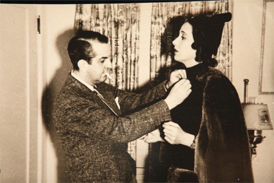 "Orry-Kelly assisting Kay Francis with her costume. (still courtesy of ""Women He's Undressed"")"