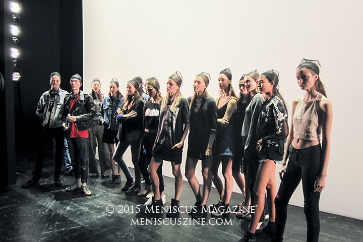 Hair still being prepped, models wait for instructions before the Vivienne Tam Spring 2016 show. (photo by Megan Lee / Meniscus Magazine)