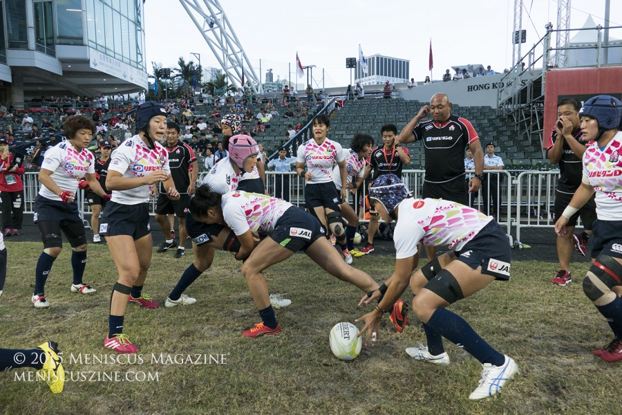 The Sakura Sevens warm up on the sidelines in Hong Kong Stadium before their final match. (photo by Yuan-Kwan Chan / Meniscus Magazine)