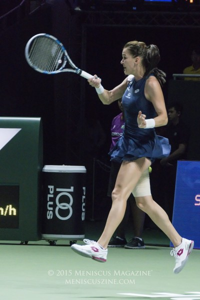 Agnieszka Radwanska - airborne during her WTA Finals victory - had just five unforced errors in her match against Petra Kvitova. (photo by Yuan-Kwan Chan / Meniscus Magazine)