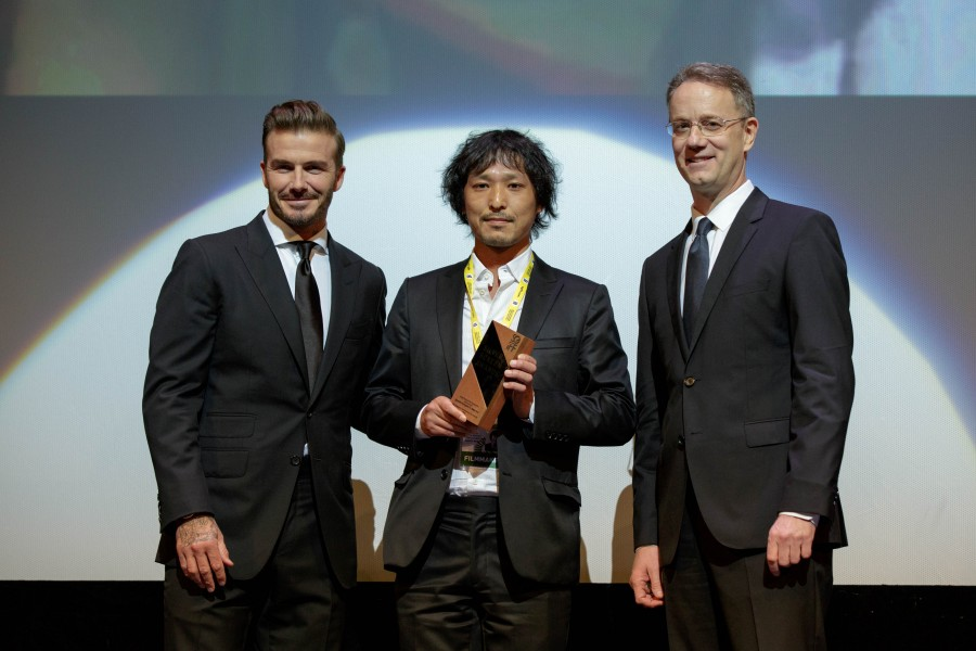 "Retired footballer and Marina Bay Sands ambassador David Beckham (left) made a surprise appearance at the 2015 Silver Screen Awards, presenting the award for Asian Feature Film - Best Director to Ryusuke Hamaguchi (center) for ""Happy Hour."" Standing with them is George Tanasijevich, President and Chief Executive Officer of Marina Bay Sands (right). (photo courtesy of the Singapore International Film Festival)"