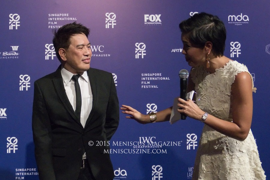 Silver Screen Awards Asian Feature Film Competition jury head Brillante Mendoza with pre-Awards host Nikki Muller. (photo by Yuan-Kwan Chan / Meniscus Magazine)
