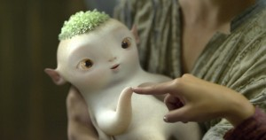 "Wuba, an adorable yet slightly creepy monster baby, strikes an E.T.-like pose in Raman Hui's ""Monster Hunt."" (still courtesy of FilmRise)"