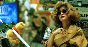 "Prepared for both the sun and the rain: Brigitte Lin as the ""woman in blonde wig"" in ""Chungking Express."" (still courtesy of the Hong Kong International Film Festival)"
