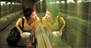 "Faye Wong on the Central–Mid-Levels escalator and walkway system in ""Chungking Express."" The system opened in Hong Kong just one year before the release of the film. (still courtesy of the Hong Kong International Film Festival)"