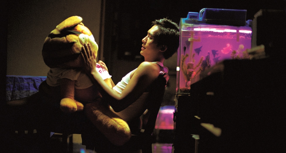 "Part of a couple of sequences where Tony Leung Chiu-Wai's character speaks to a series of inanimate objects in his apartment, ""Cop 663"" confronts a stuffed Garfield. (still courtesy of the Hong Kong International Film Festival)"