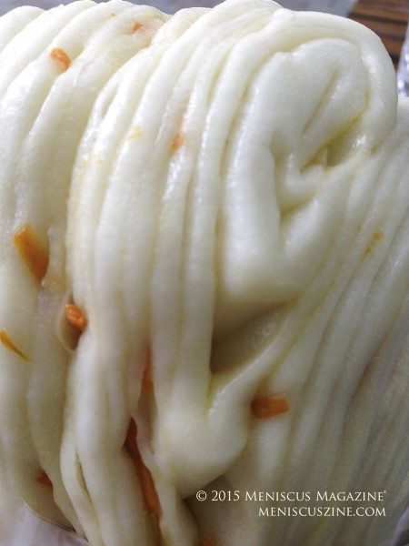 A close-up of a mantou with carrot flakes. (photo by Yuan-Kwan Chan / Meniscus Magazine)