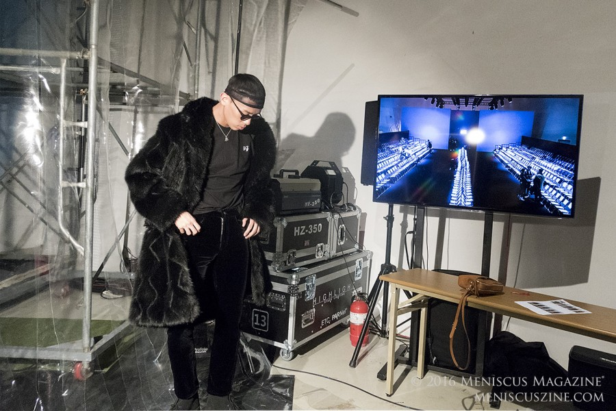 Trying to find space between equipment and a flatscreen TV showing the empty runway at Dongdaemun Design Plaza. (photo by Yuan-Kwan Chan / Meniscus Magazine)