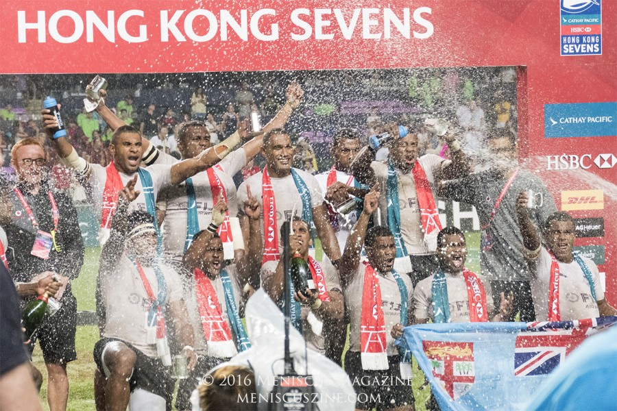 Fiji head coach Ben Ryan (top, left) and the rest of the national rugby sevens team enjoy a rain- and Champagne-soaked celebration after winning the Hong Kong Sevens 2016 title. (photo by Yuan-Kwan Chan / Meniscus Magazine)