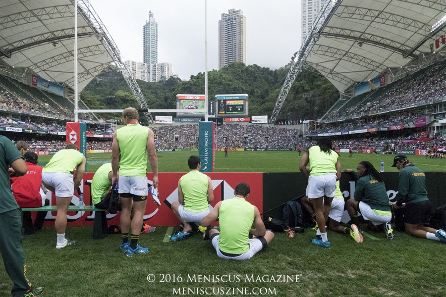 The South Africa men's rugby sevens team awaits the result of their female colleagues' title match at Hong Kong Stadium. (photo by Yuan-Kwan Chan / Meniscus Magazine)