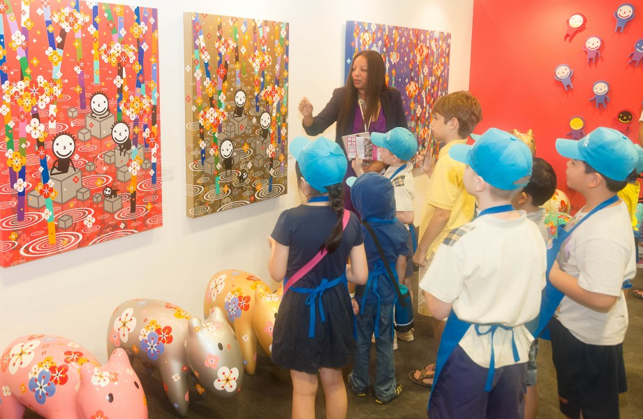 Children being led through a tour of Kwon Kisoo's work at Singapore Contemporary 2016. The children were especially enamored with the cartoon-like quality of Kwon's pieces, some of which juxtapose geometrical shapes with modern depictions of landscapes found in more traditional Korean art. (photo courtesy of Singapore Contemporary)