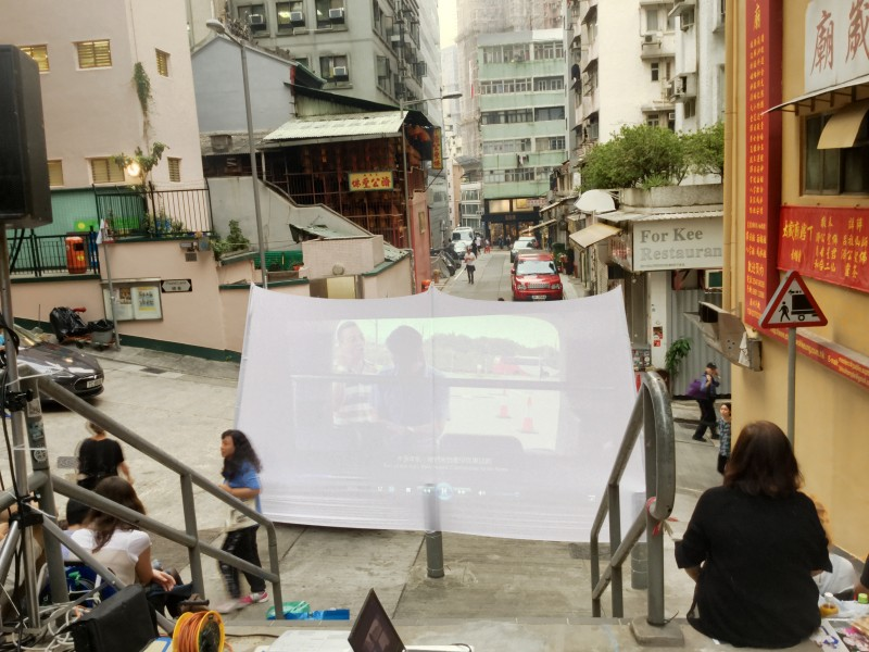 "Testing the screen before sunset at the Tai Ping Shan community screening of ""Ten Years"" in Hong Kong on Apr. 1. (photo by Yuan-Kwan Chan / Meniscus Magazine)"
