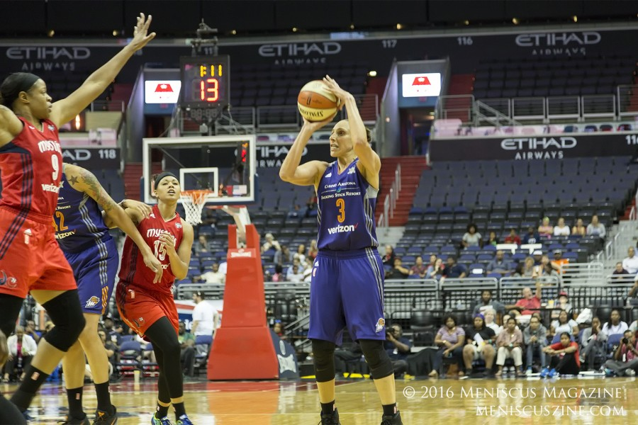 Diana Taurasi of the Phoenix Mercury prepares to launch the three-point shot that catapults her past the 7,000 mark. (photo by Kwai Chan / Meniscus Magazine)