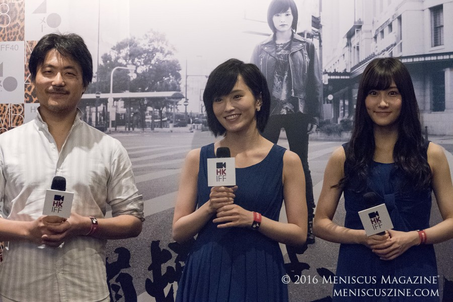"Director Atsushi Funahashi (left), and NMB48 members Sayaka Yamamoto (center) and Fuuko Yagara (right) at the April 3 press conference for ""Raise Your Arms and Twist – Documentary of NMB48."" The film shows the triumphs and struggles of the all-girl supergroup based in Osaka. (photo by Yuan-Kwan Chan / Meniscus Magazine)"