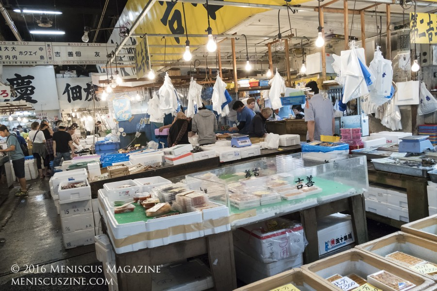 A look at The Tsukiji Market, which currently occupies prime real estate between the Tokyo neighborhood of Ginza and the Sumida River. About 75 percent of the market is scheduled to relocate to Toyosu in Tokyo Bay - about 12.3 km or 7.7 miles away from its current site - in November 2016. (photo by Kwai Chan / Meniscus Magazine)
