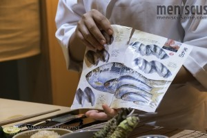 The textbooks behind the bar serve more than a decorative purpose: they're an opportunity for Sushi Masato's Chef Masa to educate his diners. (photo by Yuan-Kwan Chan / Meniscus Magazine)