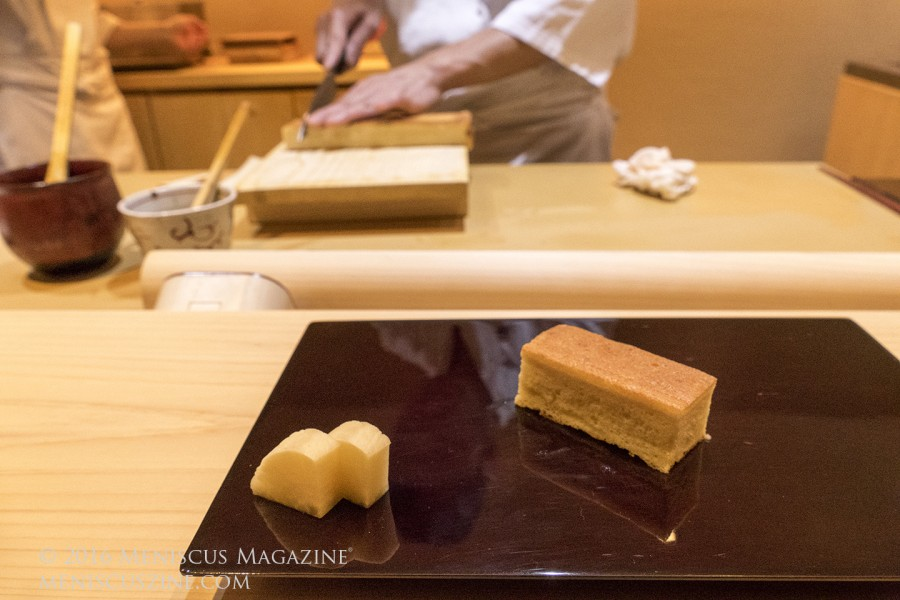 A piece of sponge cake with organic chicken egg, mountain yam and a pinch of shrimp that Chef Masa serves as sushi. The recipe is slightly modified from the same cookbook used by Chef Jiro. The cake takes several hours each day to prepare. (photo by Yuan-Kwan Chan / Meniscus Magazine)