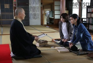 "Ai Hashimoto (far right) and Yuko Takeuchi (second from right) consult a priest for clues in ""The Inerasable."" (still courtesy of the Fantasia International Film Festival)"