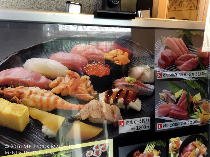 """The wait to get into one of the famed sushi restaurants at Tsukiji can last two to three hours. At Ichiba Sushi, only set menus are available, headlined by the """"A"""" omakase set for 3800 yen. A version of this set appears in the photo. (photo by Yuan-Kwan Chan / Meniscus Magazine)"""