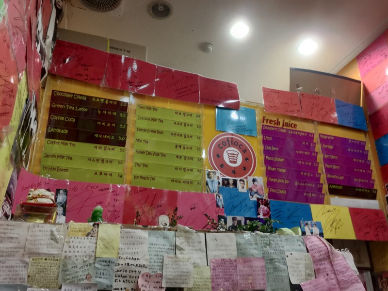Organized chaos: Laminated autographs, a two-part Cofioca beverage menu (no food!), knickknacks, and notes from fans to star customers (mostly EXO here). (photo by Yuan-Kwan Chan / Meniscus Magazine)