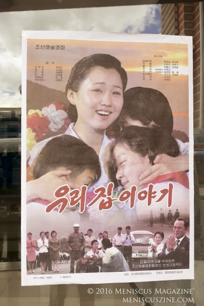 "A poster promoting ""The Story of Our Home"" at the Mirae Scientists' Street Cinema in Pyongyang."