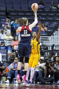 Fever forward Tamika Catchings attempts to block the Mystics' Emma Meesseman during Indiana's 80-73 victory. (photo by Kwai Chan / Meniscus Magazine)