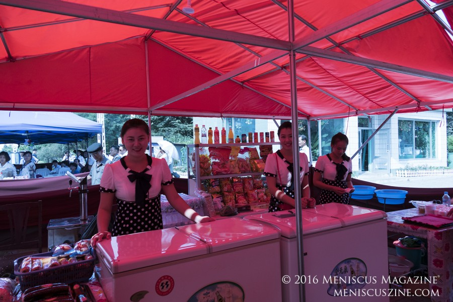 A snack tent set up just outside of Kaeson Cinema in Pyongyang. Items for sale included bottled and boxed drinks; chips; and gimbap. (photo by Meniscus Magazine)