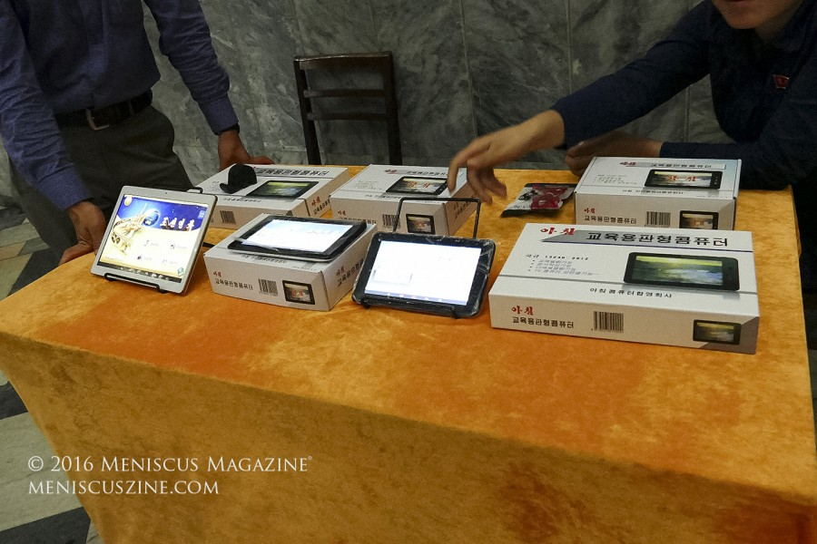 More tablets for sale, this time featured at the lone sponsor booth at the Pyongyang International Cinema House. (photo by Meniscus Magazine)