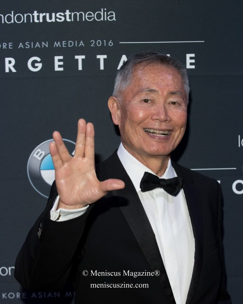 "George Takei flashes the familiar ""Live Long and Prosper"" greeting - also know as the Vulcan Salute"" - from Star Trek. (photo by Ali Zandi for Meniscus Magazine)"