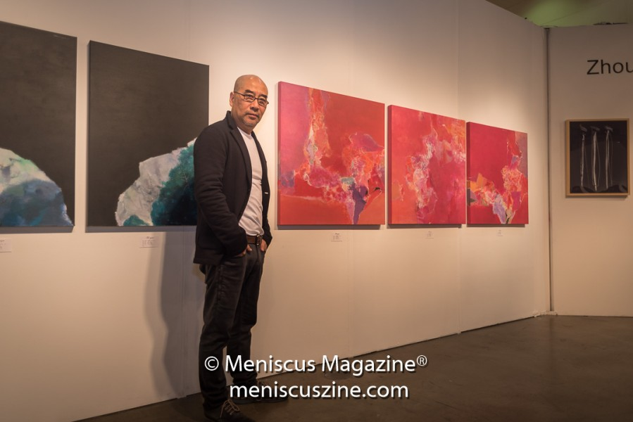 Shanghai-born artist Lu Yunhua with some of his work at the 2017 LA Art Show.  (photo by Ali Zandi / Meniscus Magazine)