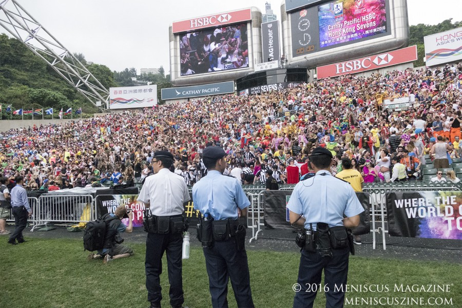 Policemen oversee the Saturday South Stand revelry at the 2016 Hong Kong Sevens. (photo by Yuan-Kwan Chan / Meniscus Magazine)
